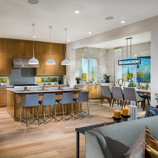 Mid-sized southwestern eat-in kitchen inspiration - Eat-in kitchen - mid-sized southwestern l-shaped light wood floor and multicolored floor eat-in kitchen idea in San Diego with flat-panel cabinets, medium tone wood cabinets, multicolored backsplash, stainless steel appliances and an island