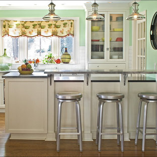 Inspiration for an eclectic kitchen remodel in Charlotte with subway tile backsplash