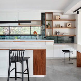 Design ideas for a contemporary galley eat-in kitchen in Melbourne with open cabinets, white cabinets, quartz benchtops, mosaic tile splashback, porcelain floors, with island, grey floor, blue splashback and white benchtop.