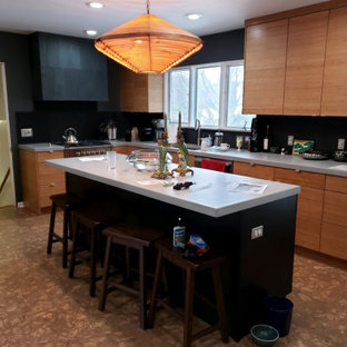 Midcentury kitchen in Grand Rapids with flat-panel cabinets, black cabinets, concrete benchtops, slate splashback and with island.