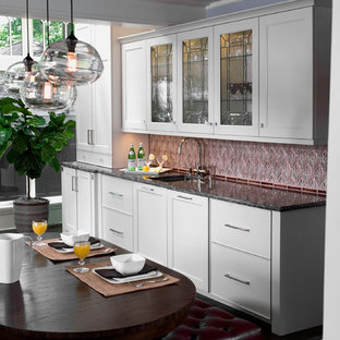 Transitional kitchen designs - Example of a transitional kitchen design in Chicago with an undermount sink, beaded inset cabinets, white cabinets, granite countertops, red backsplash, mosaic tile backsplash and stainless steel appliances