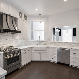 Mid-sized contemporary enclosed kitchen appliance - Example of a mid-sized trendy u-shaped porcelain tile and gray floor enclosed kitchen design in San Francisco with a farmhouse sink, raised-panel cabinets, gray cabinets, marble countertops, gray backsplash, marble backsplash and stainless steel appliances