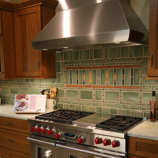 Large craftsman kitchen pantry inspiration - Kitchen pantry - large craftsman u-shaped porcelain tile and beige floor kitchen pantry idea in Sacramento with an undermount sink, shaker cabinets, medium tone wood cabinets, quartz countertops, green backsplash, ceramic backsplash, stainless steel appliances, an island and white countertops
