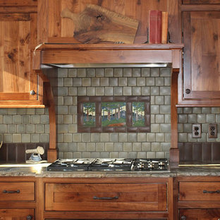 Mid-sized craftsman eat-in kitchen inspiration - Eat-in kitchen - mid-sized craftsman l-shaped eat-in kitchen idea in Other with shaker cabinets, medium tone wood cabinets, quartzite countertops, green backsplash, ceramic backsplash, stainless steel appliances, an island and white countertops