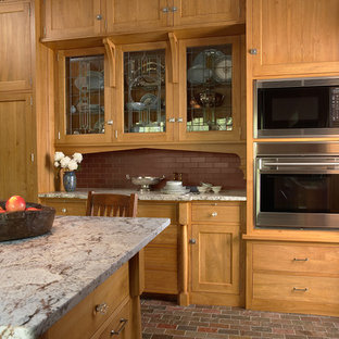 Craftsman enclosed kitchen pictures - Enclosed kitchen - craftsman u-shaped slate floor enclosed kitchen idea in Minneapolis with an undermount sink, shaker cabinets, medium tone wood cabinets, granite countertops, red backsplash, subway tile backsplash, stainless steel appliances and an island