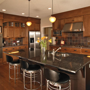 Arts and crafts kitchen in Minneapolis with stainless steel appliances and slate splashback.