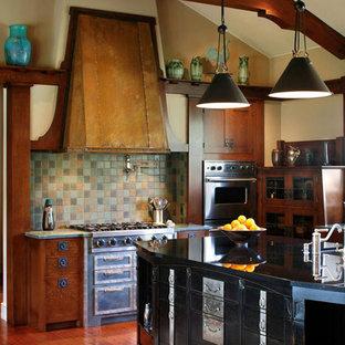 Rustic kitchen designs - Mountain style kitchen photo in Santa Barbara with dark wood cabinets, green backsplash, stainless steel appliances and slate backsplash