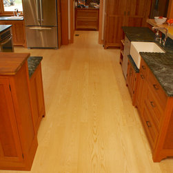 Ash Wide Plank Floors - Select Grade Sapwood Only - Acadia, New Hampshire - Strong and durable with a broad, prominent grain, Ash wide plank flooring is ideal for high traffic rooms like kitchens.  Solid Ash wide plank flooring, Select grade, available mill-direct from Hull Forest Products.