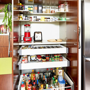 Mid-sized eclectic kitchen pantry remodeling - Kitchen pantry - mid-sized eclectic u-shaped medium tone wood floor kitchen pantry idea in Melbourne with red backsplash, glass sheet backsplash, stainless steel appliances and an island