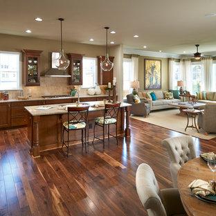 Elegant open concept kitchen photo in Denver with an undermount sink, shaker cabinets, medium tone wood cabinets, beige backsplash and stainless steel appliances