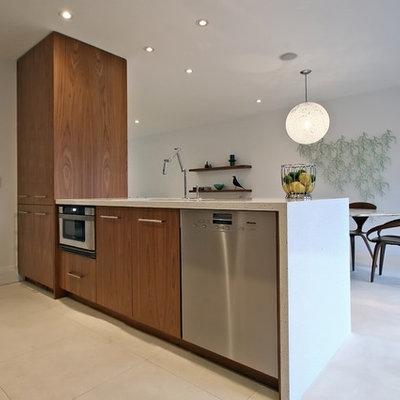 Kitchen - modern single-wall kitchen idea in Toronto