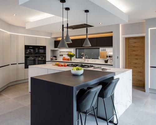 k chen mit r ckwand aus marmor und porzellan bodenfliesen ideen design bilder houzz. Black Bedroom Furniture Sets. Home Design Ideas