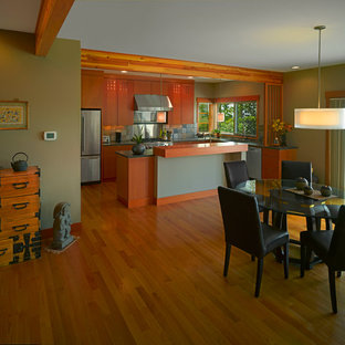 Inspiration for a mid-sized asian galley open plan kitchen in Seattle with flat-panel cabinets, medium wood cabinets, stone tile splashback, stainless steel appliances, marble floors, with island and a double-bowl sink.