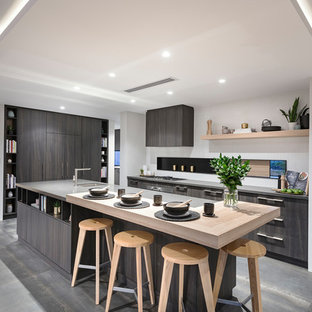 Asian l-shaped eat-in kitchen in Perth with an undermount sink, flat-panel cabinets, grey cabinets, stainless steel appliances, with island and grey floor.
