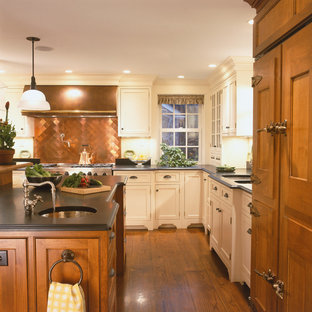 This is an example of a large country u-shaped eat-in kitchen in Other with shaker cabinets, medium wood cabinets, soapstone benchtops, stainless steel appliances, medium hardwood floors, with island, an undermount sink, metallic splashback and metal splashback.