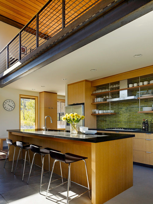 modern kitchen idea in salt lake city with medium tone wood cabinets green backsplash
