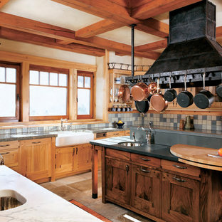 Huge mountain style u-shaped ceramic floor kitchen photo in San Francisco with stainless steel appliances, a farmhouse sink, shaker cabinets and two islands