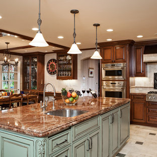 Large traditional l-shaped eat-in kitchen in San Francisco with raised-panel cabinets, beige splashback, an undermount sink, medium wood cabinets, granite benchtops, ceramic splashback, panelled appliances, ceramic floors and with island.