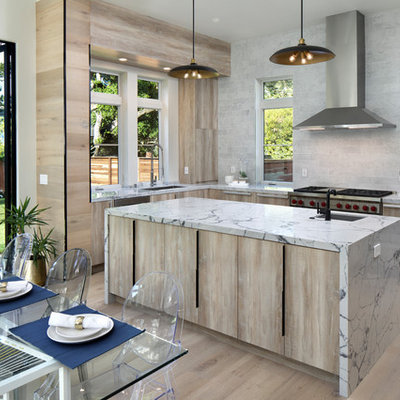 Eat-in kitchen - contemporary u-shaped light wood floor and beige floor eat-in kitchen idea in San Francisco with an undermount sink, flat-panel cabinets, light wood cabinets, gray backsplash, stainless steel appliances, an island and white countertops