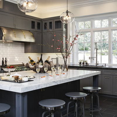 Inspiration for a transitional kitchen remodel in San Francisco with gray cabinets, marble countertops, white backsplash and subway tile backsplash