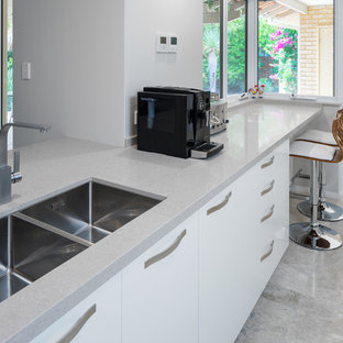 Modern kitchen appliance - Minimalist kitchen photo in Perth with an undermount sink, flat-panel cabinets, white cabinets, quartz countertops, stainless steel appliances and gray countertops