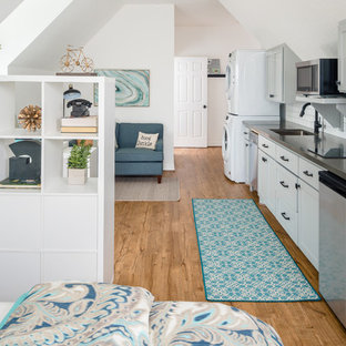 Small transitional open concept kitchen ideas - Small transitional single-wall vinyl floor open concept kitchen photo in Houston with an undermount sink, shaker cabinets, gray cabinets, quartz countertops, white backsplash, ceramic backsplash, stainless steel appliances and no island