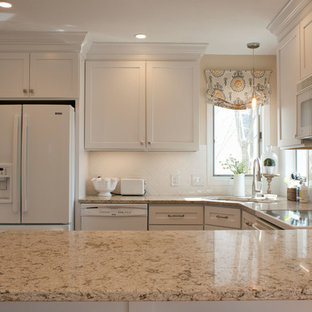 Design ideas for a mid-sized traditional u-shaped separate kitchen in Cedar Rapids with a double-bowl sink, shaker cabinets, white cabinets, granite benchtops, white splashback, ceramic splashback, white appliances, medium hardwood floors and a peninsula.
