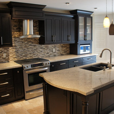 Eat-in kitchen - mid-sized contemporary l-shaped ceramic tile eat-in kitchen idea in Toronto with an undermount sink, raised-panel cabinets, dark wood cabinets, granite countertops, beige backsplash, glass sheet backsplash, stainless steel appliances and an island