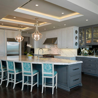 Contemporary kitchen appliance - Example of a trendy l-shaped kitchen design in Austin with recessed-panel cabinets, white cabinets, white backsplash and stainless steel appliances