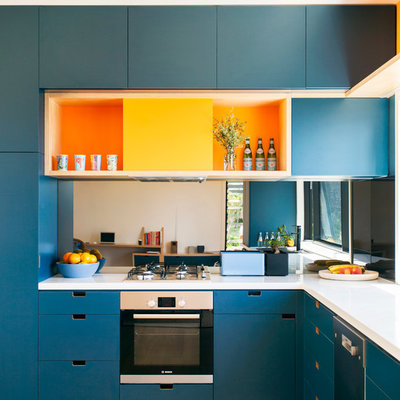 Kitchen - contemporary l-shaped medium tone wood floor kitchen idea in Sydney with flat-panel cabinets, blue cabinets and stainless steel appliances