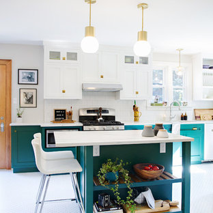 This is an example of a large transitional separate kitchen in Other with shaker cabinets, marble benchtops, white splashback, ceramic splashback, stainless steel appliances, porcelain floors, with island, multi-coloured floor, turquoise cabinets and white benchtop.