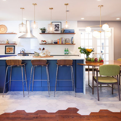 Open concept kitchen - mid-sized eclectic u-shaped white floor open concept kitchen idea in Charleston with a farmhouse sink, flat-panel cabinets, blue cabinets, white backsplash, stainless steel appliances and an island