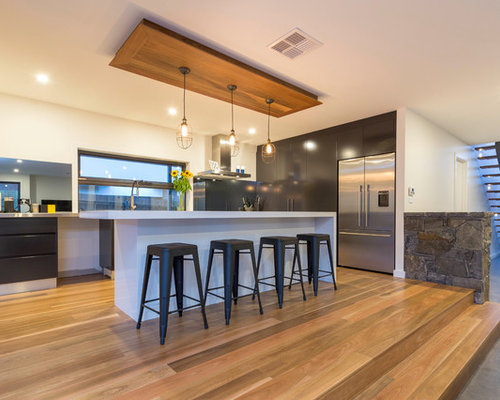 Kitchen with Mirror Backsplash and Stainless Steel Countertops Design Ideas & Remodel Pictures ...