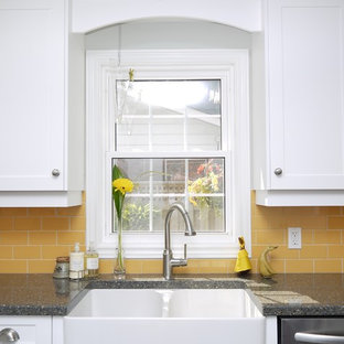 This is an example of a mid-sized country l-shaped separate kitchen in Toronto with a farmhouse sink, recessed-panel cabinets, white cabinets, quartz benchtops, yellow splashback, porcelain splashback, stainless steel appliances and with island.