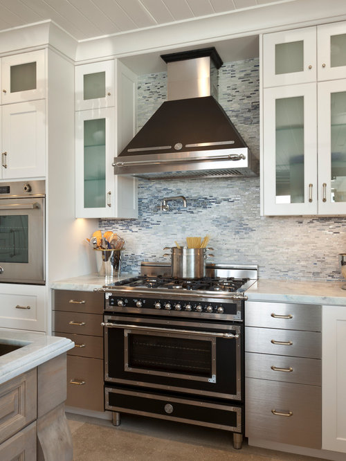 example of a transitional kitchen design with mosaic tile backsplash