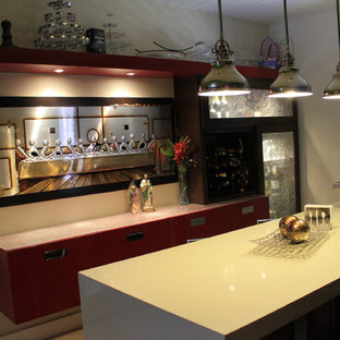 Large contemporary eat-in kitchen ideas - Inspiration for a large contemporary galley eat-in kitchen remodel in Phoenix with flat-panel cabinets, red cabinets, quartzite countertops, metallic backsplash, metal backsplash, stainless steel appliances and two islands