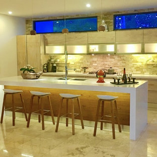 Design ideas for a large asian single-wall eat-in kitchen with an undermount sink, flat-panel cabinets, light wood cabinets, solid surface benchtops, multi-coloured splashback, stone tile splashback, stainless steel appliances, marble floors and with island.