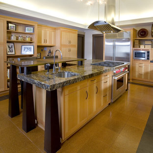 Asian kitchen appliance - Example of a zen kitchen design in Portland with stainless steel appliances, granite countertops, flat-panel cabinets, light wood cabinets, brown backsplash, mosaic tile backsplash and a single-bowl sink