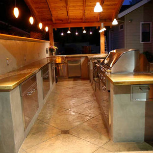 Large tropical eat-in kitchen ideas - Large island style l-shaped concrete floor eat-in kitchen photo in San Francisco with a double-bowl sink, concrete countertops, stainless steel appliances and a peninsula
