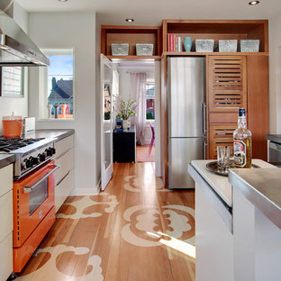 This is an example of a contemporary separate kitchen in Seattle with zinc benchtops and coloured appliances.