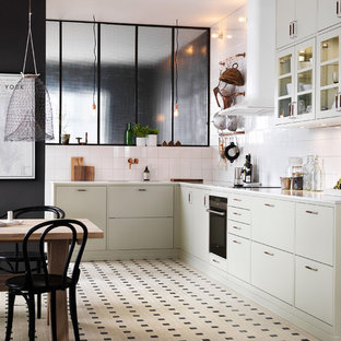 Large industrial l-shaped eat-in kitchen in Malmo with a double-bowl sink, flat-panel cabinets, granite benchtops, ceramic floors, no island and beige cabinets.