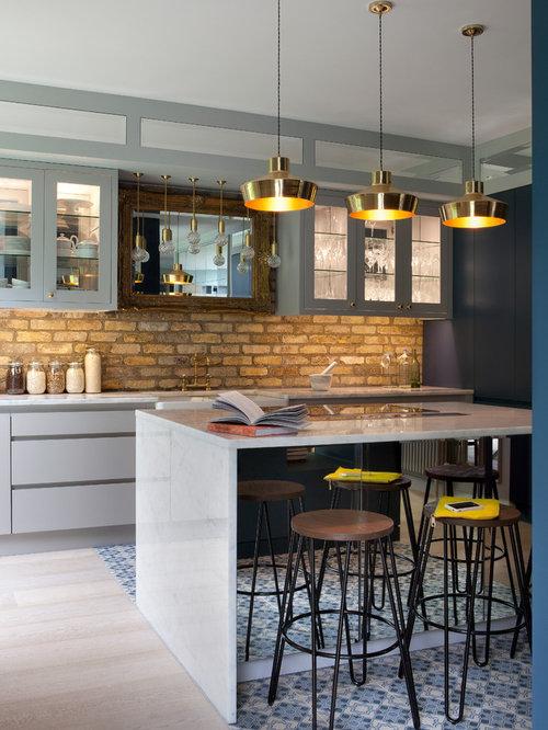Cucina industriale con ante di vetro foto e idee per arredare - Ante in vetro cucina ...