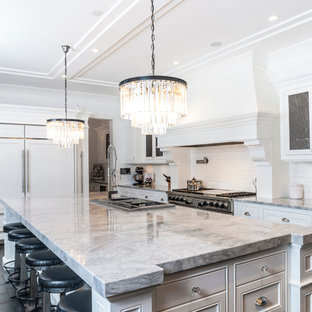 Transitional kitchen photo in Edmonton with recessed-panel cabinets, white cabinets, white backsplash and paneled appliances