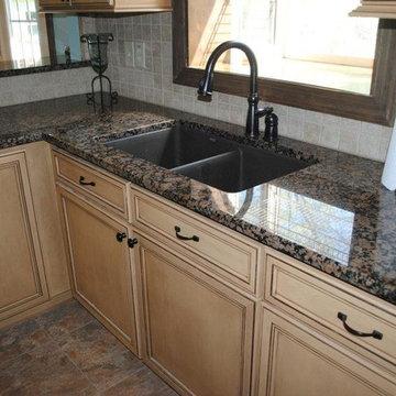 Baltic Brown Granite with Tile Backsplash. Maple Cabinets