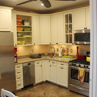 This is an example of a large traditional l-shaped eat-in kitchen in Baltimore with an undermount sink, recessed-panel cabinets, white cabinets, granite benchtops, orange splashback, stainless steel appliances and ceramic floors.