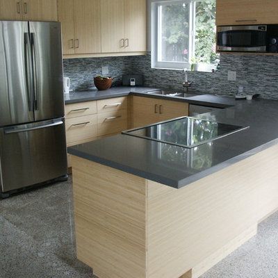 Eat-in kitchen - mid-sized contemporary u-shaped concrete floor eat-in kitchen idea in Miami with a double-bowl sink, flat-panel cabinets, light wood cabinets, quartz countertops, gray backsplash, matchstick tile backsplash, stainless steel appliances and a peninsula