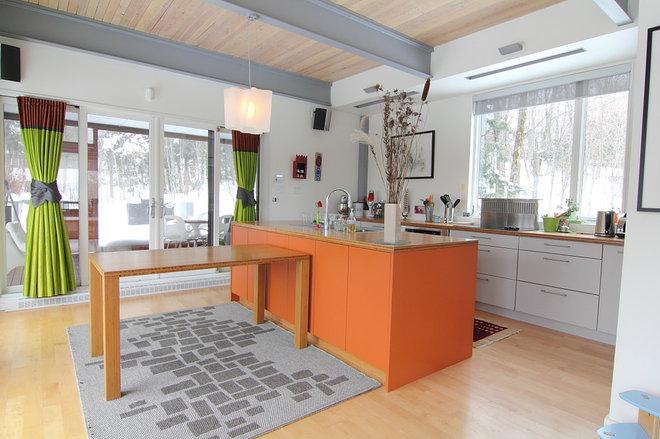 Eclectic Kitchen by Handwerk Interiors