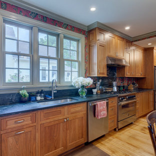 This is an example of a large midcentury kitchen pantry in Other with an undermount sink, beaded inset cabinets, medium wood cabinets, soapstone benchtops, green splashback, stone slab splashback, stainless steel appliances, no island and green benchtop.