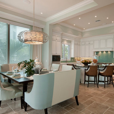 Example of a transitional beige floor eat-in kitchen design in Miami with white cabinets and paneled appliances