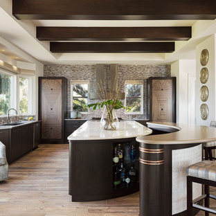 Design ideas for a large transitional kitchen in Miami with flat-panel cabinets, dark wood cabinets, onyx benchtops, a single-bowl sink, multi-coloured splashback, mosaic tile splashback, light hardwood floors and multiple islands.